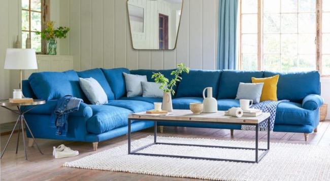 Преимущества угловых диванов в гостиной